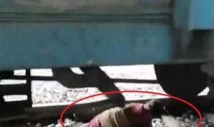فيديو يظهر مشهدا مرعبا لعجوز لحظة استلقائها بين عجلات القطار