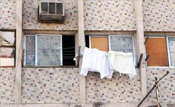 محافظ العاصمة: حظر نشر الملابس والمفروشات على واجهات المباني